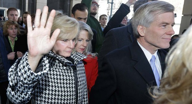 Former Virginia Gov. Bob McDonnell, right, and his wife, Maureen, left, are surrounded by family and supporters as they leave Federal court in Richmond, Va. (AP Photo/Steve Helber)