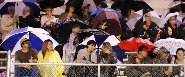 And the rain kept fans huddled under umbrellas.