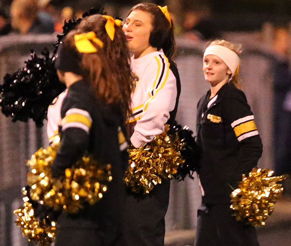 Cheerleaders try to keep up the spirit