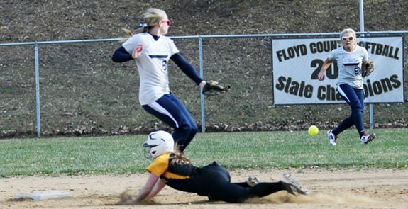 A successful steal in varsity softball against Carroll County.
