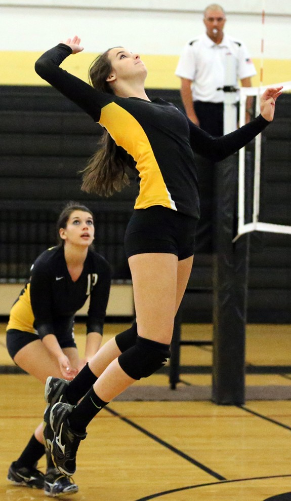2014 Volleyball action at home.