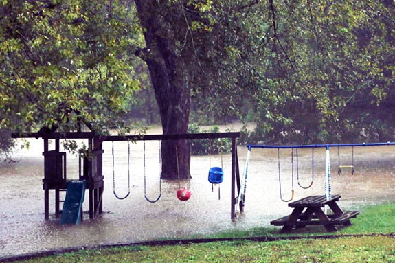 Little River overflows its banks near U.S. 221 and Poor Farm Road (All Photos from Doug Thompson)