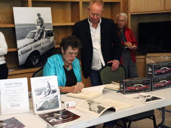 Margaret Sue Turner Wright autographs her book at the event Sunday.