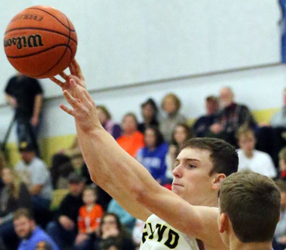 Jared Spence of the Buffaloes scores one of his five three-point shots. (Photos by Doug Thompson)
