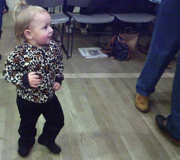 A youngster gets into a dancing mood.