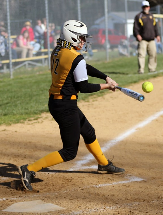 Mary Phillips connects for one of her two hits for Floyd County.