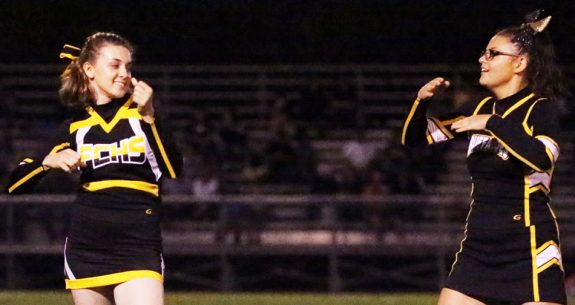 Cheerleaders celebrate in a halftime performance.