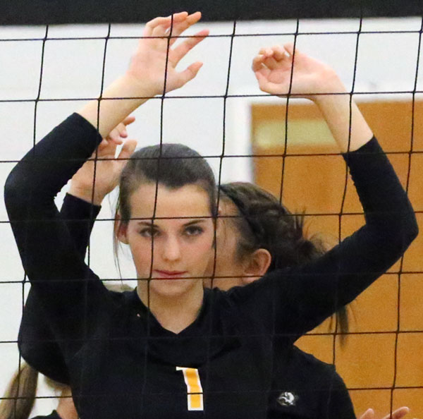 Haley Avencini of the Buffaloes volleyball team staring down an opponent just before the ball is served.