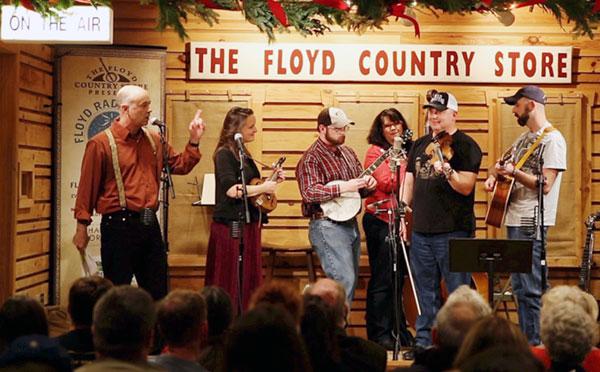 Floyd Radio Show guest host Ralph Berrier Jr. (left introduces The New Ballard Branch Bogtrotters at the December 2016 Floyd Radio Show.