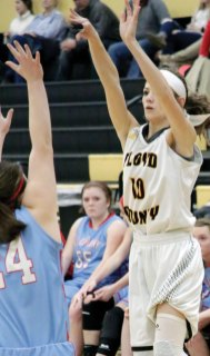 Aimee Whtlow goes for a 3-pointer.