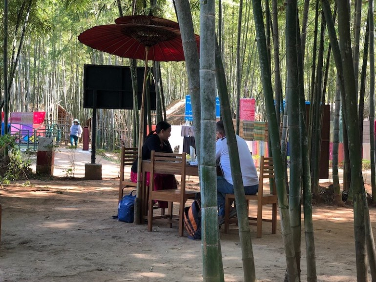 cafe in bamboo forest inle lake, blue sky and wine