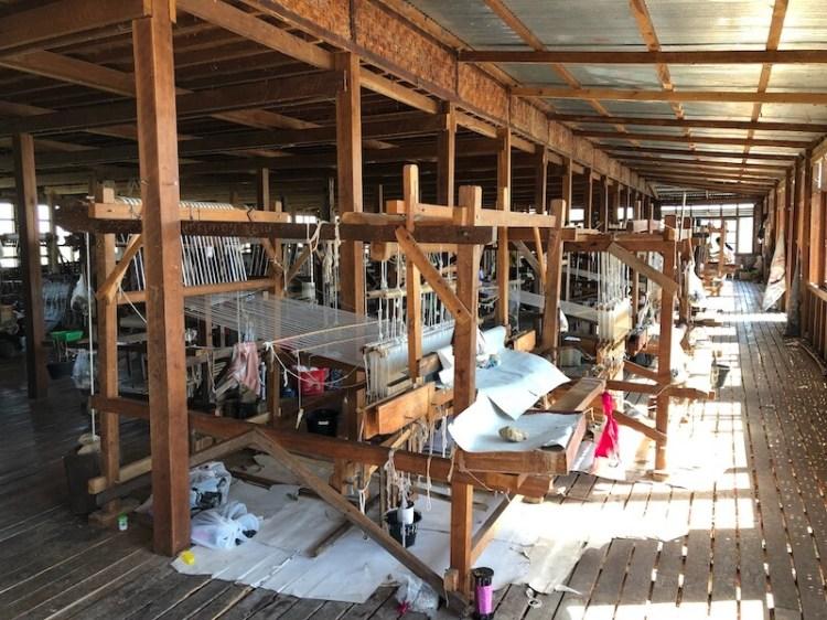 weaving factory inle lake myanmar blue sky and wine