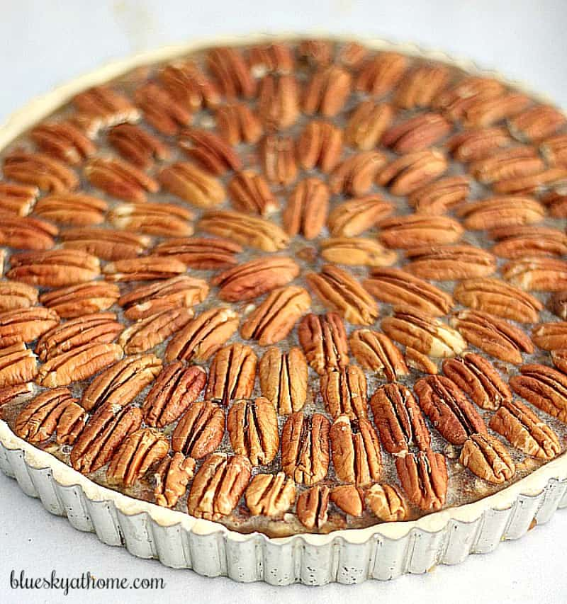 Pecan Rum Tart Is the Perfect Dessert for Thanksgiving. This tart combines rum and dark karo syrup filling in a tart pan for an extra pretty presentation.