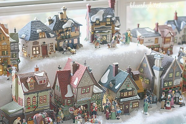 How Our Holiday Home Sparkles and Shines for Christmas with lights and ornaments in gold and silver with reindeer, Santas and snowmen.