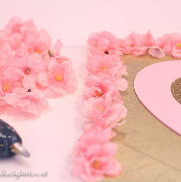 3 DIY Decorations for a Valentine's Party under $10; make your party special with a front door sign to welcome guests and a heart garland for a fun touch.