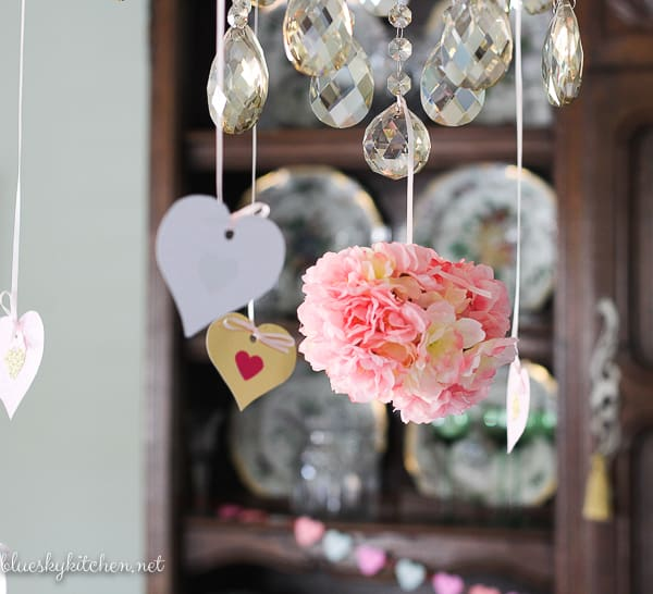 2 DIY Valentine's Party Decorations under $10; make your party special with a front door sign to welcome guests and a heart garland for a fun touch.