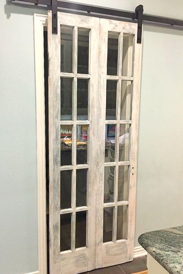 How to Transform French Doors into a Barn Door ~ how we made flea market French doors into a barn door for laundry room using Amy Howard at Home paint.