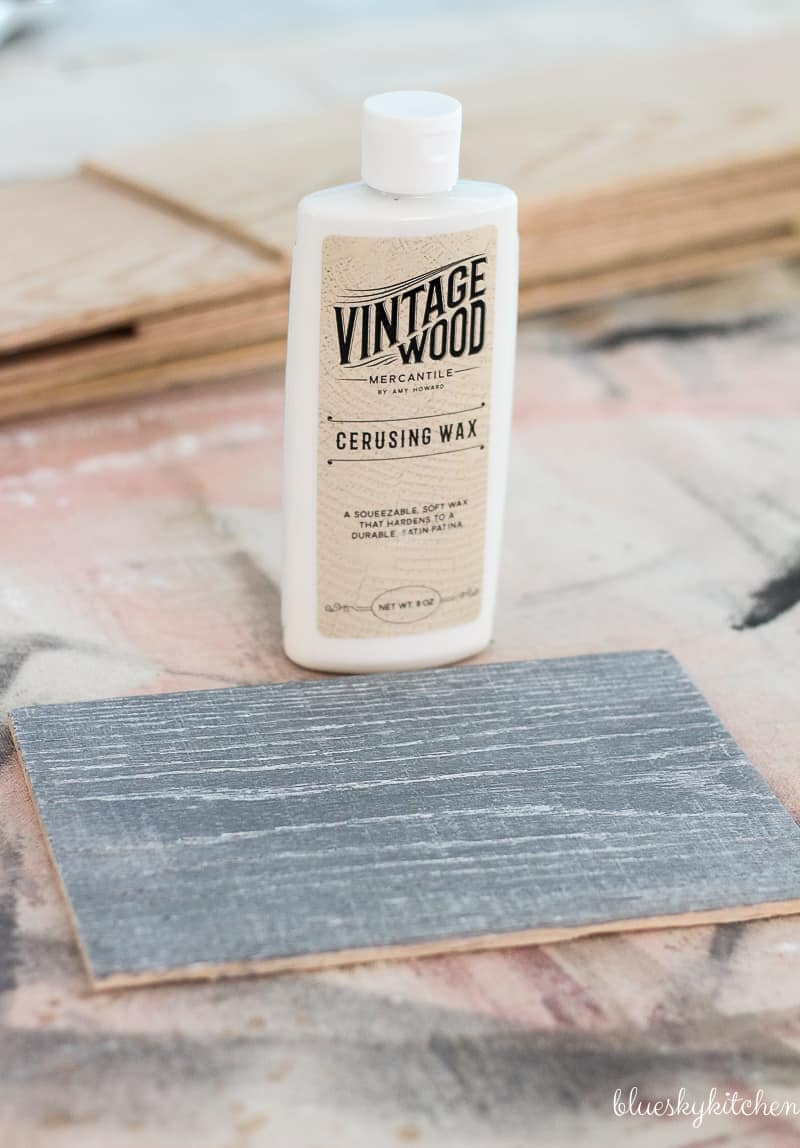 How to Create a Weathered Wood Backsplash. Palette Wall in a Box and Amy Howard at Home products created a weathered looking wall as a backsplash.