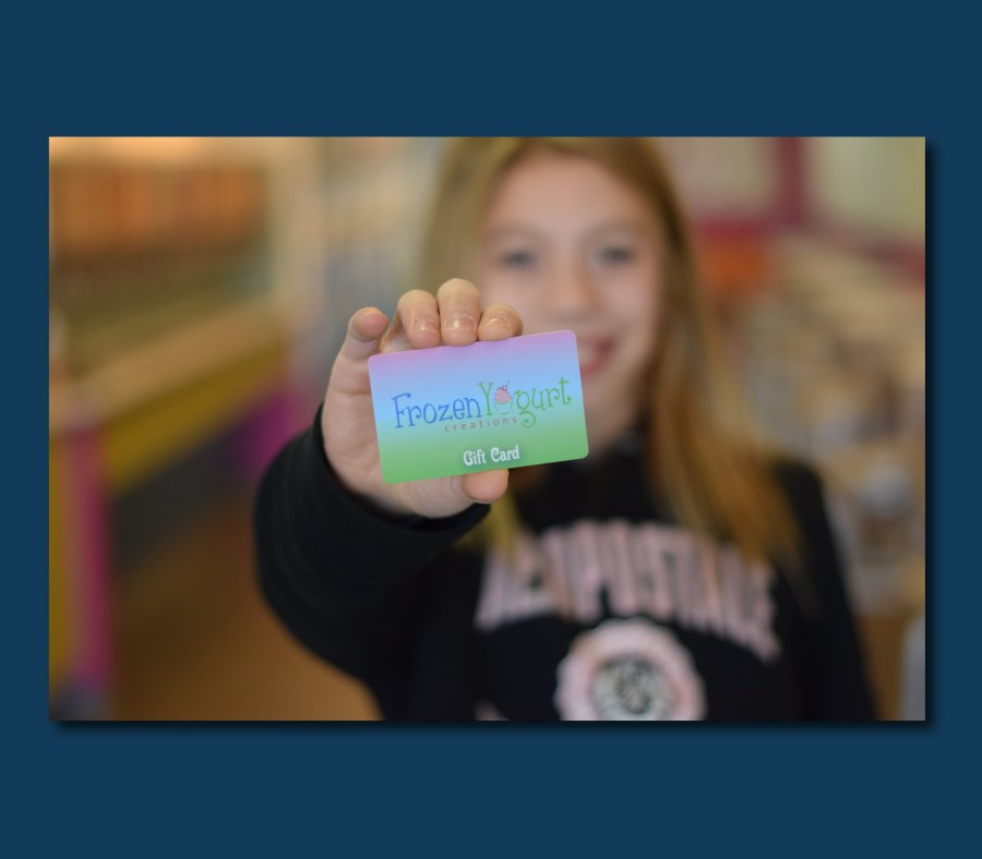 girl holding Frozen Yogurt Creations gift card