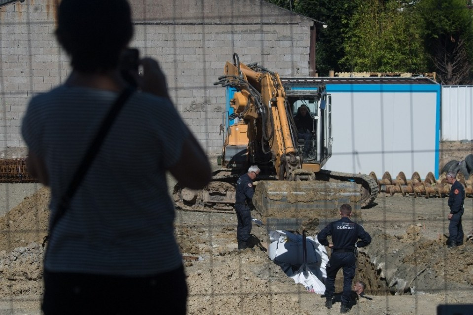 Some 2,300 residents were evacuated as the experts dug a hole around the bomb before cutting it up and taking it away to be destroyed (AFP Photo/LOIC VENANCE)