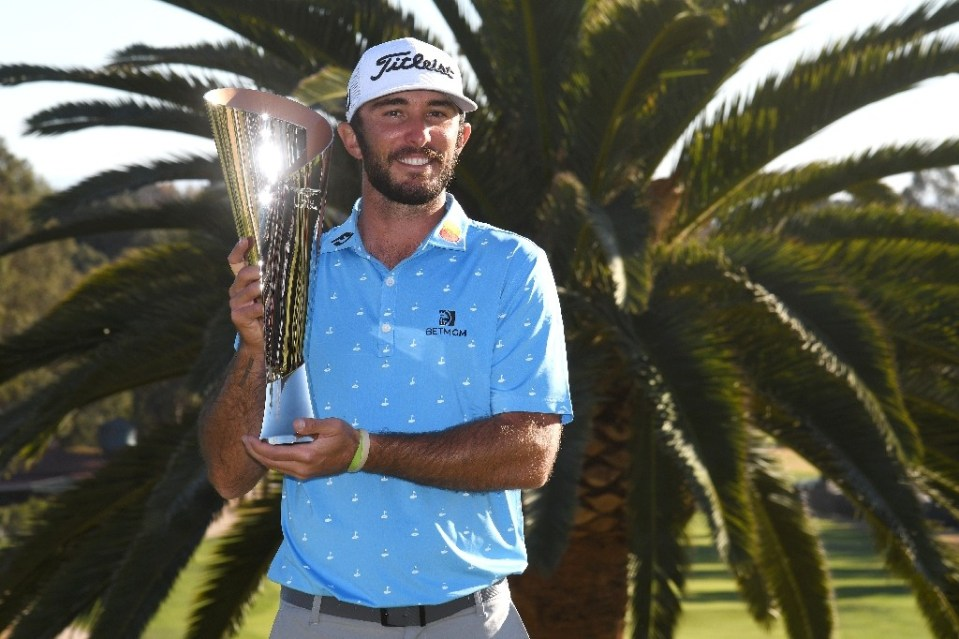 American Max Homa lifted the trophy Sunday at the US PGA Genesis Invitational after beating compatriot Tony Finau in a playoff at Riviera Country Club - Harry How / ©AFP