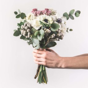 cropped shot of woman holding beautiful bridal bouquet isolated