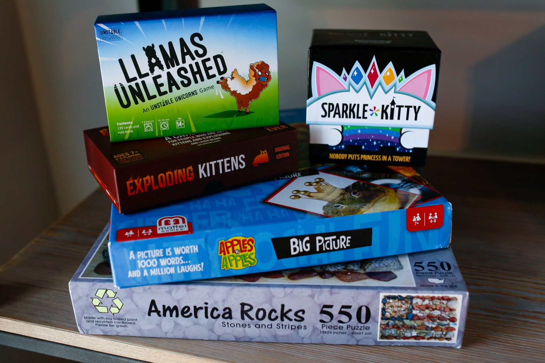 stack of board games and card games for family game night