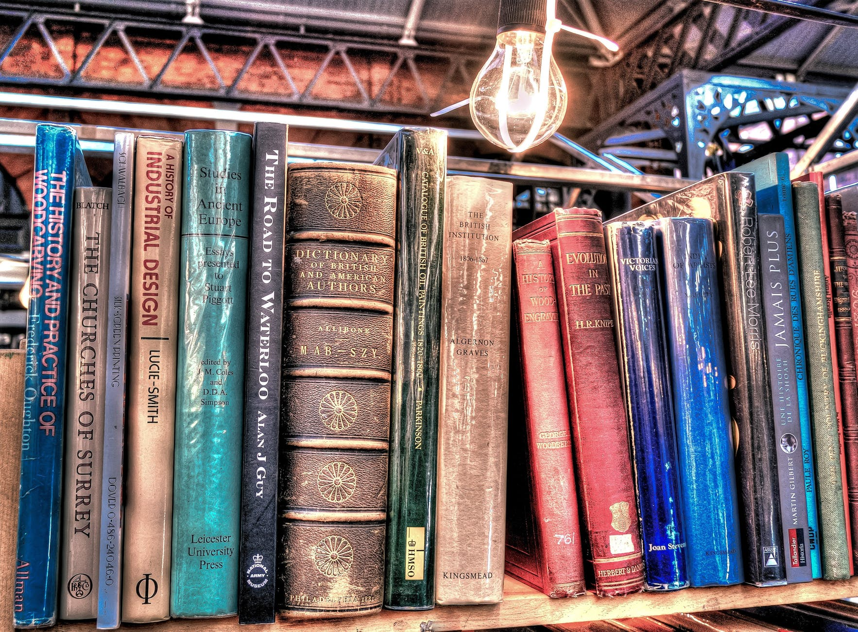 aged antique book stack books