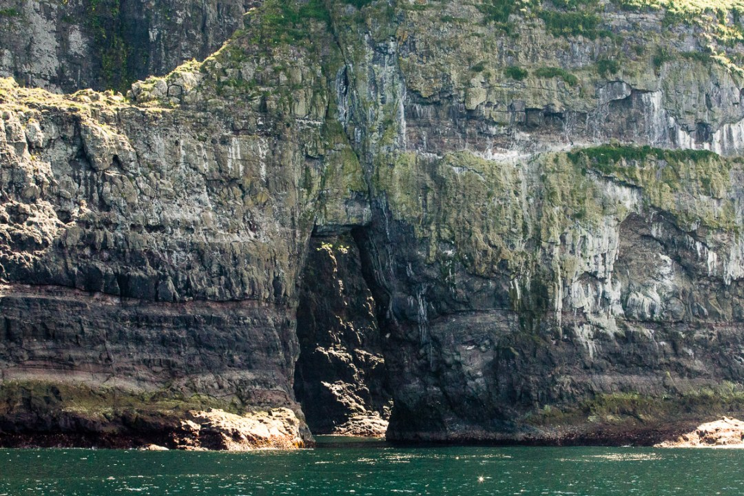 Opening in massive rock formation near Vestmanna, Faroe Islands - Blurbomat.com