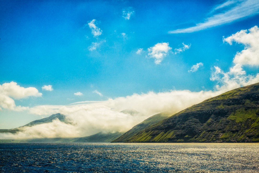 Clouds envelope a land mass, Faroe Islands - Blurbomat.com