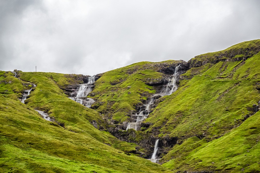 Waterfall on Streymoy, right before the sub-sea tunnel to Vagar, Faroe Islands. by Jon Armstrong for Blurbomat.com.