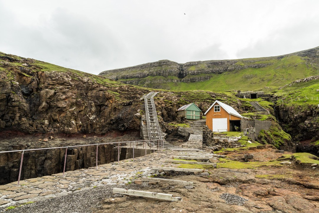 A long boat ramp and boat houses on Suðuroy, Faroe Islands.