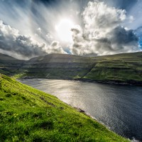 Clouds Explode Above Tjørnuvík - Looking down into the village of Tjørnuvík, Faroe Islands | shot by Jon Armstrong for Blurbomat.com