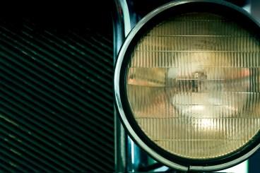 Right headlight on a vintage car.