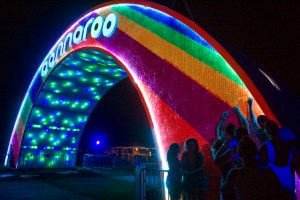 Festival goers remove small pieces of plastic off of the Bonnaroo arch to have a keepsakes during the final day of Bonnaroo Sunday, Jun 14, 2015. (JESSICA TEZAK/NEWS SENTINEL)