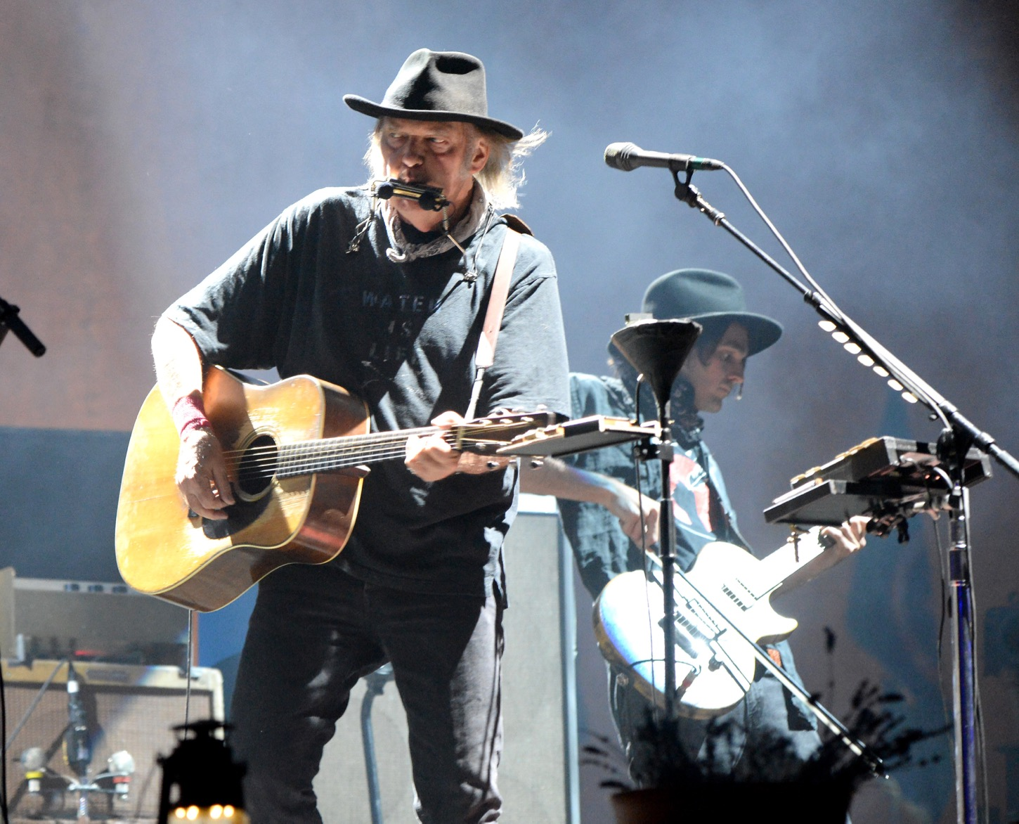 INDIO, CA - OCTOBER 15: Musicians Neil Young and Jacob Micah Nelson perform with Promise of the Real onstage during Desert Trip at The Empire Polo Club on October 15, 2016 in Indio, California. (Photo by Kevin Mazur/Getty Images for Desert Trip). Used With Permission.