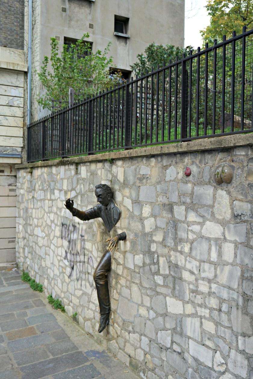 man-in-wall-paris