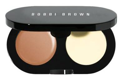 The Bobbi Brown Creamy Concealer kit comes with a creamy concealer with orange undertones that help cancel out dark under eye circles and a powder that sets the concealer in place so it lasts longer.