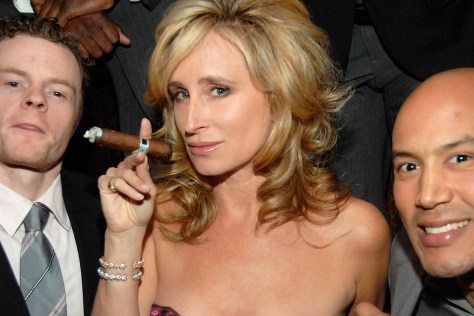 Sonja Morgan having a cigar with some gentleman friends.