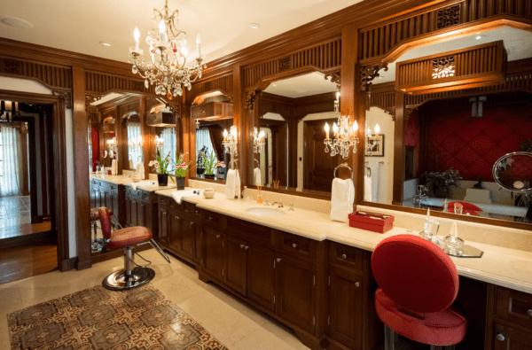 Erika Jayne's master bathroom from Pasadena Magazine shows a salon chair, but no shampoo bowl.