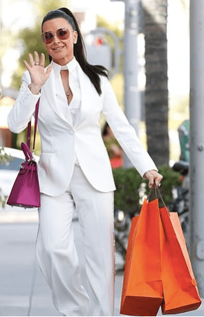 Kyle Richards heading to Andy Cohen's baby shower in Beverly Hills with her magenta pink Birkin and Hermes shopping bags. Did Kyle Richards get Andy Cohen Hermes baby gifts?