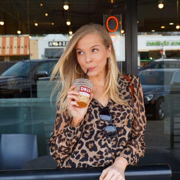 Me wearing leopard print long sleeved button down sheer blouse from Amazon Fashion at Drop Coffee Co in Dallas, TX