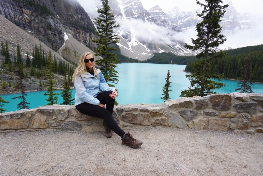 wearing layers at Moraine Lake in Banff, Canada in the summertime