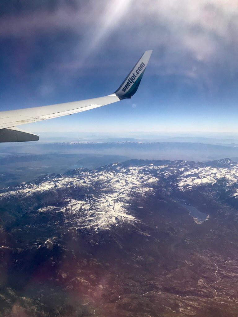 Flying on West Jet airlines from LAX to YYC to go to Banff, Canada