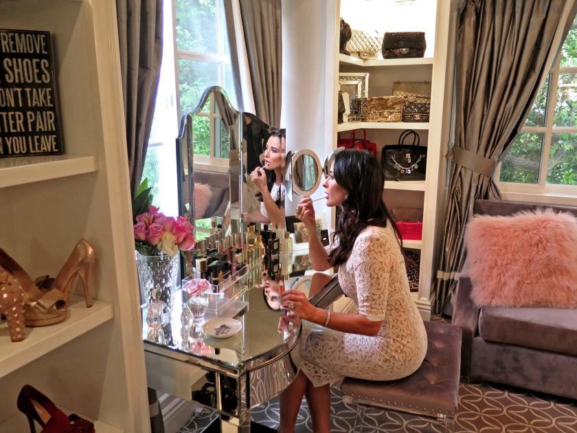 Kyle Richards applying lip gloss at her vanity