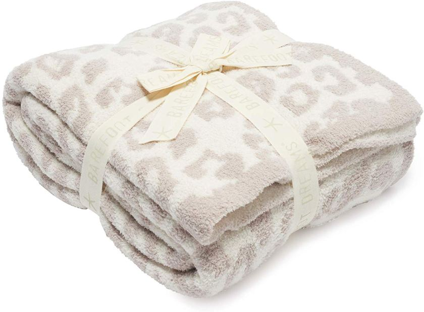 barefoot dreams in the wild snow leopard printed blanket