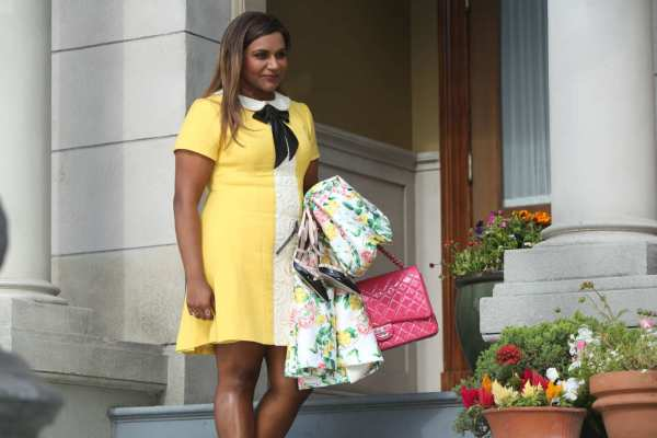 Mindy Project main character in yellow dress.