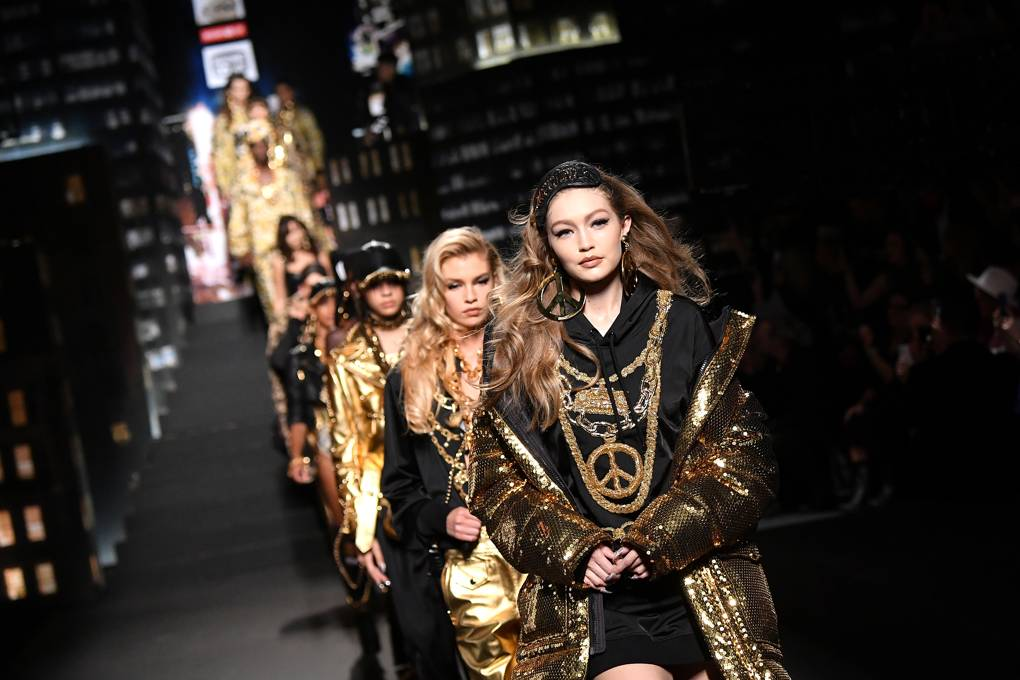 Gigi Hadid leading the parade of models on the Moschino x H&M runway