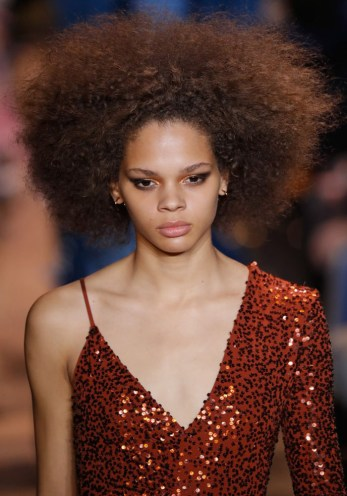 Michael Kors styled this model with her natural hair in an afro- a homage to 70s disco.
