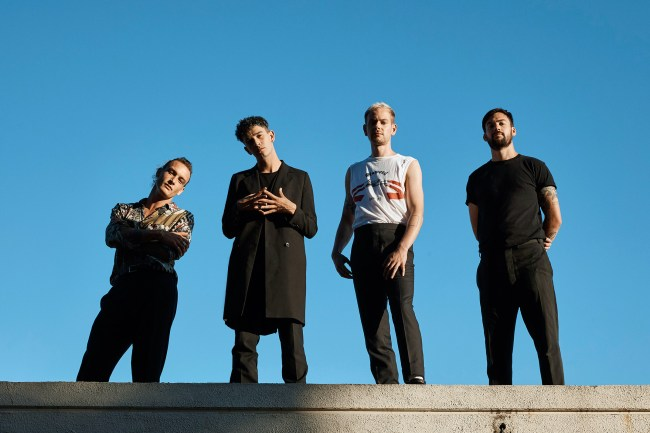 The 1975 Group Image against a blue sky